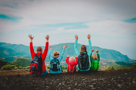 happy family with kids travel in scenic nature