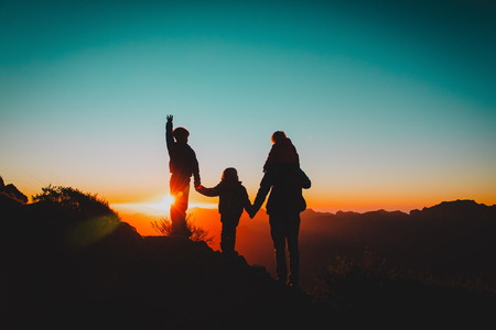 happy father with kids travel in sunset mountains, family hiking in nature Stock Photo