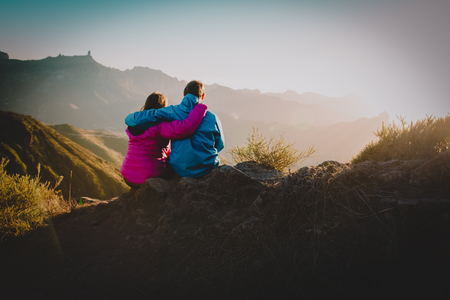 happy loving couple hiking in mountains, family travel in nature Stock Photo