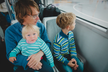 father with kids travel by bus, family using public transport