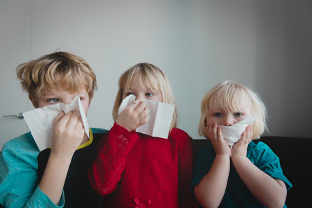 kids wiping and blowing nose, infection or allergy Stok Fotoğraf - 118824313