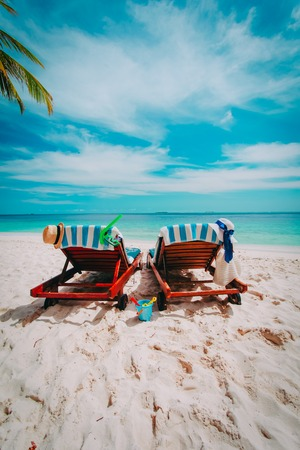 Two chairs on the tropical beach, vacation at sea