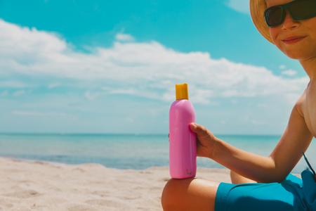 sun protection- little boy with suncream on beach