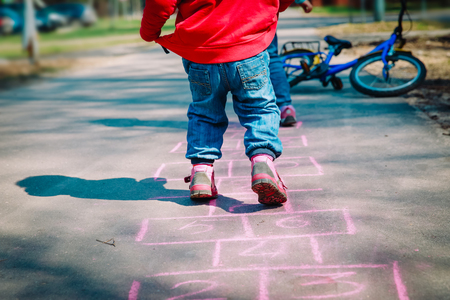 little girl play hopscotch on playground, outdoor activities for kids