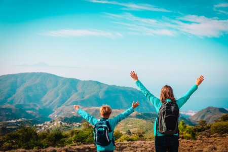 mother and son travel in nature, family hiking in mountains Stock Photo