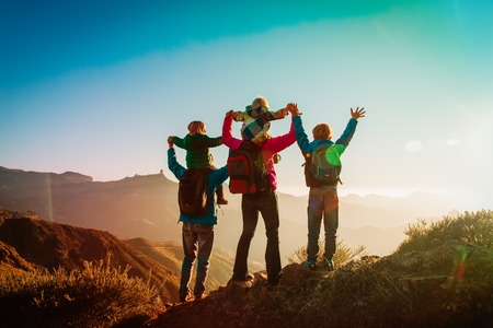happy family travel in mountains at sunset Standard-Bild