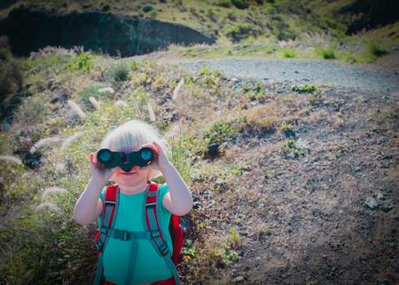 family travel- little girl with binoculars exploring nature Stock fotó - 119044030