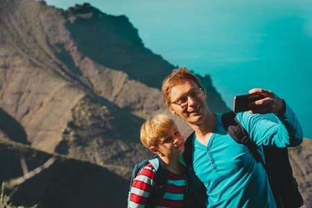father and son making selfie while travel in Canary islands, Spain 版權商用圖片