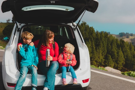 happy mother with kids enjoy travel by car in nature Banque d'images - 119044229