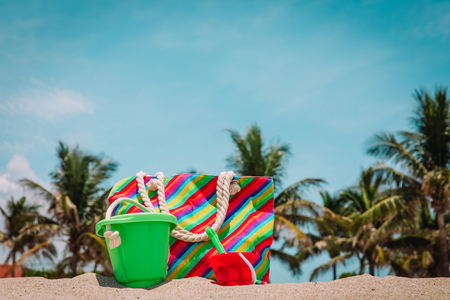bag and toys on beach vacation, family at sea 写真素材 - 119654393