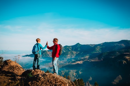 father and son travel in nature, family hiking in mountains Banco de Imagens