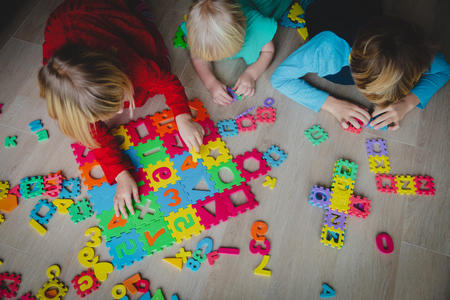 kids learning numbers and shapes, family play with puzzle, learning through play