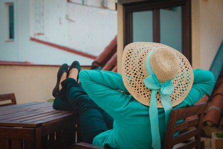 young woman relax on balcony terrace in the city