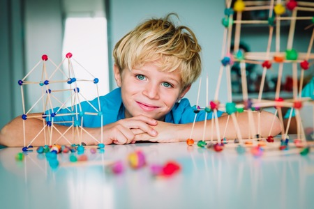 cute boy making geometric shapes, engineering and STEM