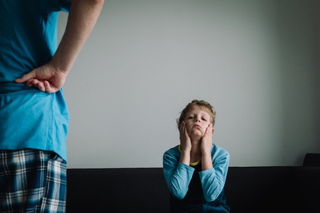 angry parent looking at tired, ashamed and exhausted kid Stock Photo