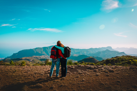 happy loving couple enjoy hiking in mountains