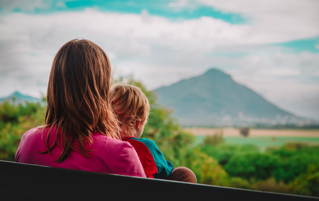 mother and little son looking at beautiful landscape of Mauritius