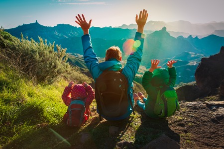 happy father and kids travel in sunset mountains 版權商用圖片