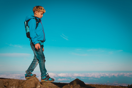boy with backpack hiking travel in mountains Stock Photo