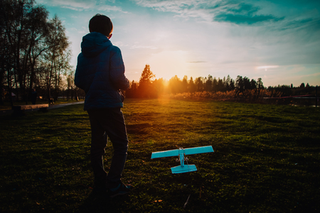 boy play with toy play in sunset nature Stock Photo