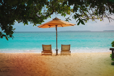 Two beach chairs on tropical vacation at sea Reklamní fotografie