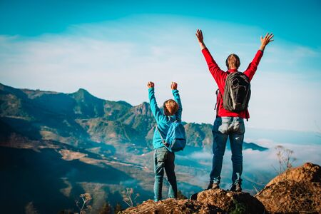 father and son travel in nature, family hiking in mountains 版權商用圖片