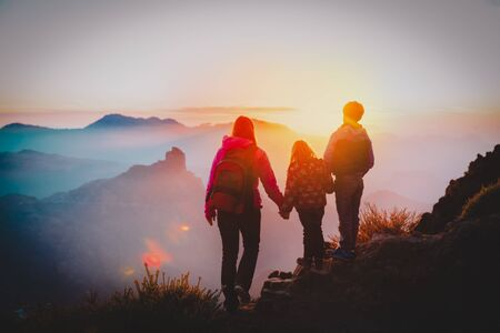 mother with kids travel in sunset mountains
