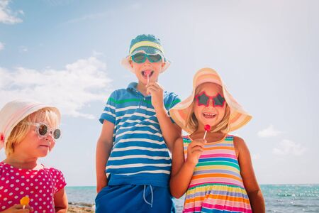 happy kids with lollipops on summer vacation