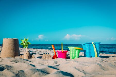 sand toys on tropical beach, kids play on sea vacation