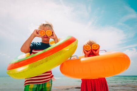 happy boy and girl enjoy summer vacation, showing orange eyes