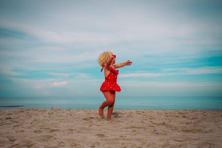 cute little girl dance, child play at summer beach