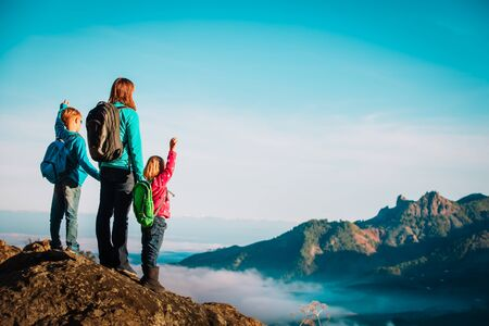 happy mother and kids hiking in scenic mountains Imagens