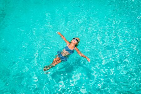 little girl relax in water on beach or pool, vacation Imagens