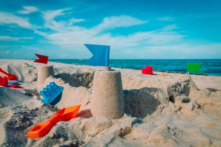 Sand castle on beach vacation and toys