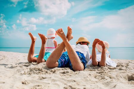 father with kids relax on beach vacation, family at sea