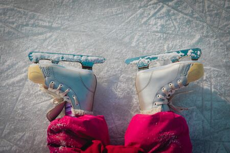 child feet learning to skate on ice in winter Banco de Imagens