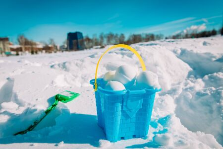 kids toys and snowballs in winter nature, kids play outdoors