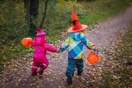 little girls run to trick or treat, halloween celebration
