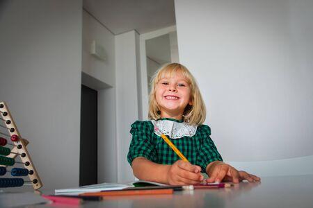 cute little girl enjoy learning, happy kid writing homework Stok Fotoğraf