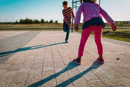 kids playing hopscotch on playground outdoors, playtime Imagens