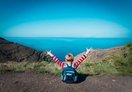 happy young boy enjoy travel hiking in mountains Stock Photo