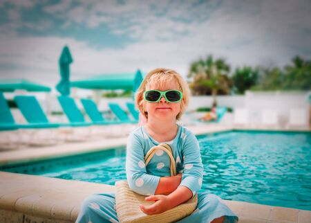 cute little girl on vacation in tropical beach resort