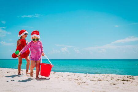 cute little girls celebrating christmas on tropical beach Stock fotó
