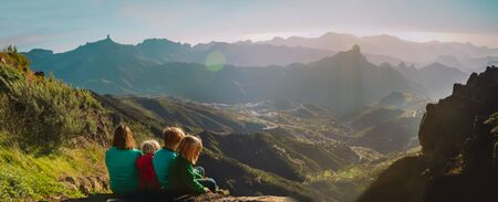Mother with kids travel in mountains, family hiking in nature Imagens