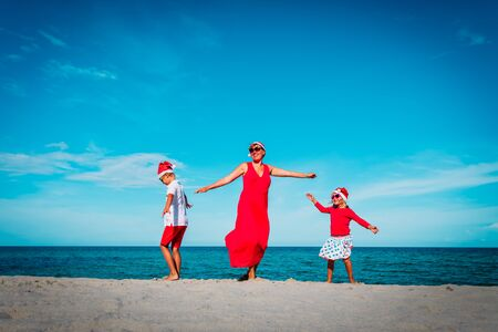 Happy mother with kids on tropical Christmas vacation Stok Fotoğraf