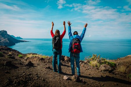 happy loving couple hiking travel in mountains
