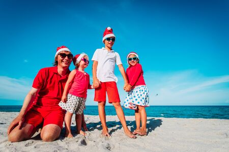 Happy father with kids on tropical Christmas vacation Stok Fotoğraf