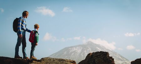 father and son travel in mountains, family enjoy hiking in nature