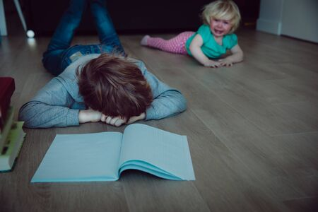 family problems-little boy tired of homework, sister crying Zdjęcie Seryjne