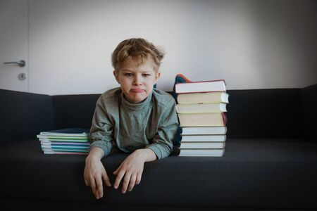 child protest against learning, kid stress from reading, doing homework Stok Fotoğraf